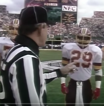 Referee and Redskins football player at Coin Toss cermony